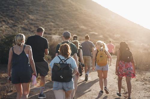 people hiking through the desert